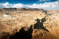 The view west from the top of Masada rock in the Judean Desert of Israel reveals remnants of the Roman Tenth Legion encampment and wall used to lay siege to the last Jewish resistance following the fall of Jerusalem in 70 CE.