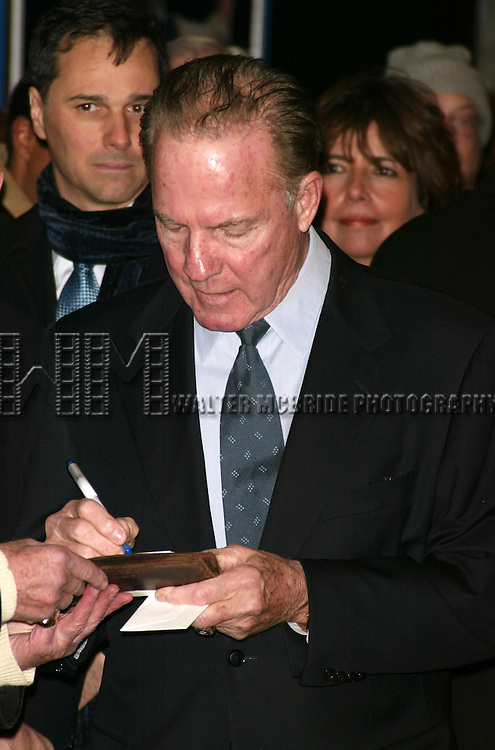 Frank Gifford<br /> ( Signing Autographs )<br /> Attending the Opening Night performance of <br /> FIDDLER ON THE ROOF at the Minskoff Theatre in <br /> New York City.<br /> February 26, 2004