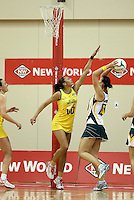 25.10.2012 Australia's Chanel Gomes in action during the England v Australia netball test match as part of the Quad Series played at the TSB Arena Wellington. Mandatory Photo Credit ©Michael Bradley.