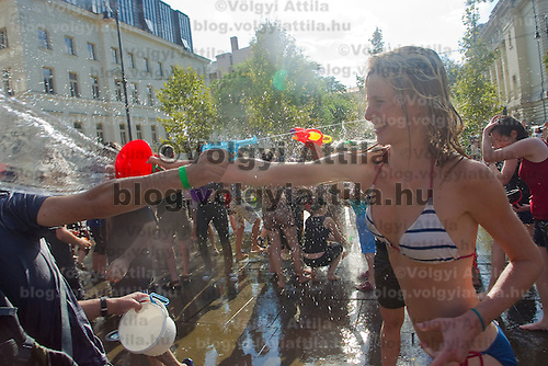 Public water fighting on the streets of Budapest, Italy. Saturday, 21. August 2010. ATTILA VOLGYI