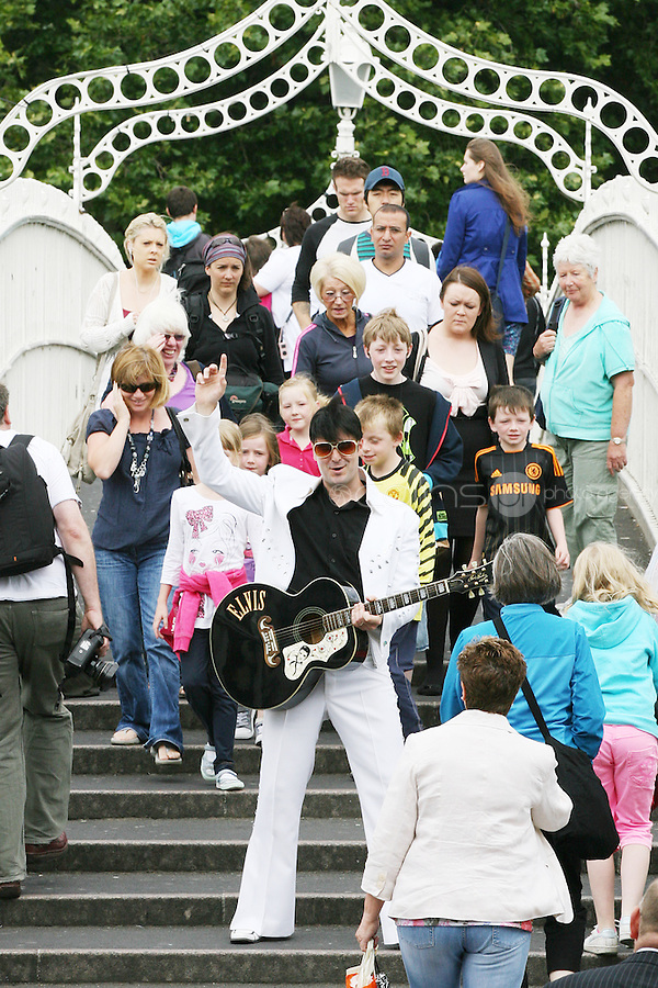 "NO REPRO FEE. 11/8/2010. Elvis Presley Story. Irelands foremost Elvis performer Kevin Doyle is pictured in his Elvis costume rehearsing on the Ha Penny Bridge Dublin in preparation for his show "" Kevin Doyle Sings the Elvis Presley Story"" this Sunday the 15th of August at the Olympia Theatre. Tickets are from 25.50 including booking fee on sale now. Picture James Horan/Collins Photos"