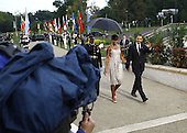 Pittsburgh, PA - September 24, 2009 -- United States President Barack Obama  and first lady Michelle Obama arrive to the welcoming dinner for G-20 leaders at the Phipps Conservatory on Thursday, September 24, 2009 in Pittsburgh, Pennsylvania. Heads of state from the world's leading economic powers arrived today for the two-day G-20 summit held at the David L. Lawrence Convention Center aimed at promoting economic growth.  .Credit: Win McNamee / Pool via CNP