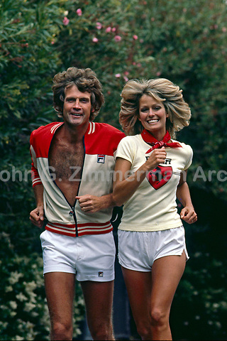 Lee Majors and wife Farrah Fawcett jog near their home in Los Angeles, May 1977. Photo by John G. Zimmerman.