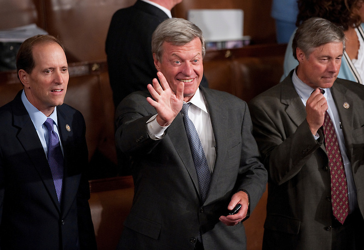 UNITED STATES - SEPTEMBER 8: Sen. Max Baucus, D-Mont., center, waves to Vice President Joe Biden as Reps. Dave Camp, R-Mich., left, and Rep. Fred Upton, R-S.C., look on before President Barack Obama's speech on jobs to a joint session of Congress on Thursday, Sept. 8, 2011. (Photo By Bill Clark/Roll Call)