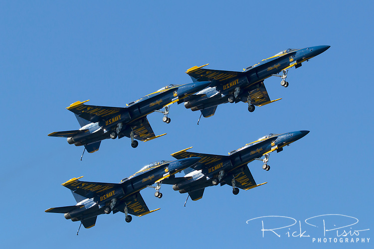 Blue Angels aircraft perform the Dirty Formation Pass as part of their flight demonstration over San Francisco Bay. The Blue Angels fly the Boeing built F/A-18 Hornet.