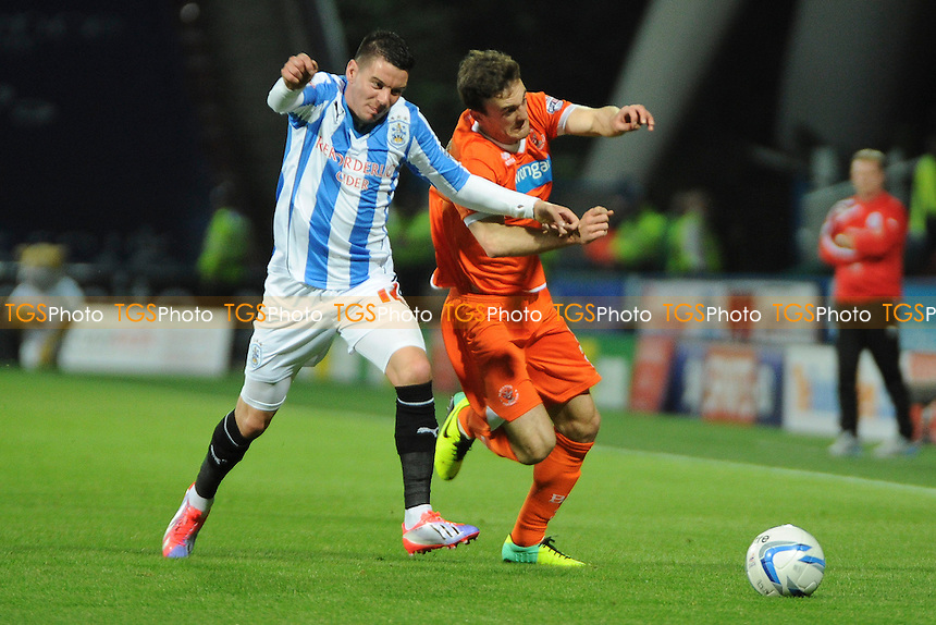 Adam Hammill of Huddersfield Town vies for the ball with Jack Robinson of Blackpool - Huddersfield Town vs Blackpool - Sky Bet Championship Football at the John Smiths Stadium, Huddersfield, West Yorkshire - 27/09/13 - MANDATORY CREDIT: Greig Bertram/TGSPHOTO - Self billing applies where appropriate - 0845 094 6026 - contact@tgsphoto.co.uk - NO UNPAID USE