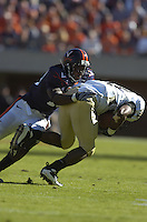 03 November 2007:  Virginia CB Ras-I Ras-i Dowling (19) makes a tackle.  The Virginia Cavaliers defeated the Wake Forest Demon Deacons  17-16 November 3, 2007 at Scott Stadium in Charlottesville, VA..