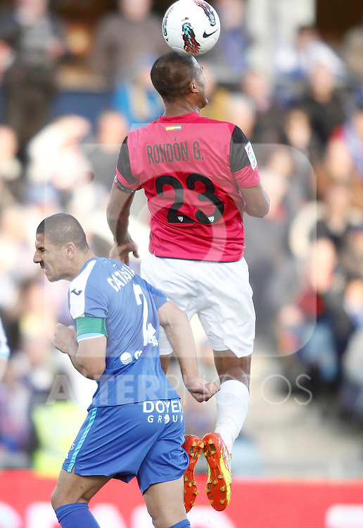 Getafe's Daniel Cata Diaz against Malaga's Jose Salomon Rondon during La Liga Match. March 03, 2012. (ALTERPHOTOS/Alvaro Hernandez)
