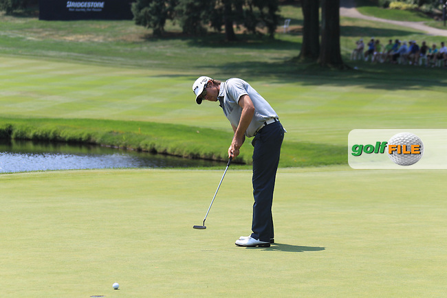 Aaron Baddeley (AUS) sinks his putt on the 16th green during Friday's Round 2 of the 2012 World Golf Championship Bridgestone Invitational at The Firestone Country Club, Akron, Ohio, USA 3rd August 2012 (Photo Eoin Clarke/www.golffile.ie)