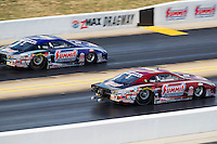 Sep 17, 2016; Concord, NC, USA; NHRA pro stock driver Greg Anderson (right) races alongside teammate Jason Line during qualifying for the Carolina Nationals at zMax Dragway. Mandatory Credit: Mark J. Rebilas-USA TODAY Sports