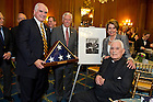 May 22, 2013; Congressmen Mike Kelly, ' 70 for Pennsylvania and  Steny Hoyer for Maryland, present Emeritus Rev. Theodore M. Hesburgh, C.S.C., an American flag with House Democratic leader Nancy Pelosi, during a special reception celebrating his 96th birthday in the Rayburn Room of the U.S. Capitol. The reception was also held to a honor his 70th anniversary as a priest of the Congregation of Holy Cross. Photo by Barbara Johnston/University of Notre Dame