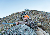 Outdoor Life Editor Andrew McKean celebrates a kill with guide Greg Kriese with Trefren Outfitters on Greyback Ridge in the Hoeback Drainage of Wyoming Region H, outside of Alpine, Wyoming, Monday, September 21, 2015. <br /> <br /> Photo by Matt Nager