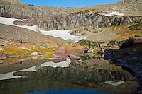 Small alpine tarn (pond),  Glacier National Park, Montana.  Fall.