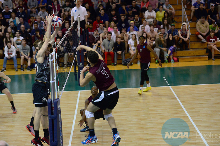 26 Apr 2015:  Stevens Institute of Technology Duck's John Eddins (24) and Daniel Smith (6) block the shot of Springfield College Pride's Ricardo Padilla Ayala (7) during the Division III Men's Volleyball Championship at Canavan Arena in Hoboken, NJ. Stevens Institute  defeated Springfield College 3-0 to win the national title.  Porter Binks/NCAA Photos