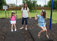 Whitney Killebrew plays Friday, June 26, 2020, with her daughters Sloane Killebrew (left), 4, and Audrey Killebrew, 7, at the park in their Bentonville neighborhood. Go to nwaonline.com/200627Daily/ to see more photos.<br /> (NWA Democrat-Gazette/Ben Goff)