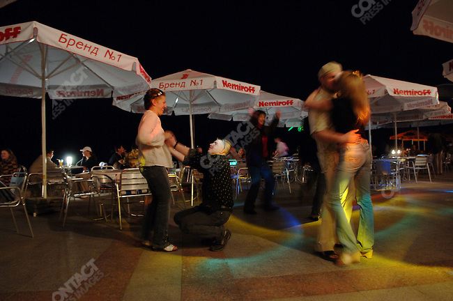 A couple dances on Yalta's seafront promenade. Republic of Crimea, May 27, 2006.