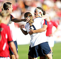 Charli Lloyd (middle) celebrates goal and been giving gratulation from Heather O'Reilly (9) and Shannon Boxx (l). USA 4,  Norway 0, Fredrikstad Stadium, July 2, 2008.