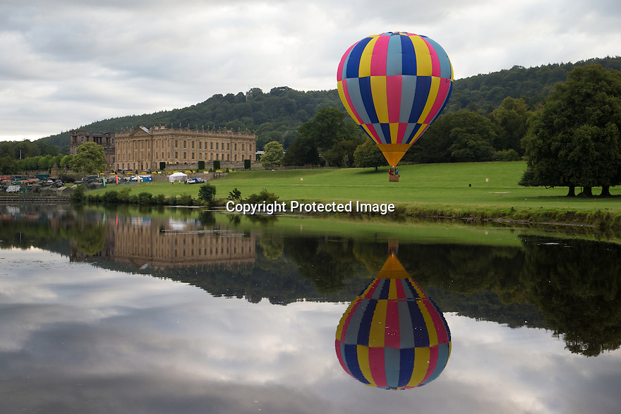 """04/09/15<br /> <br /> ***WITH VIDEO***<br /> <br /> Hot air balloon pilots attempt to dip their baskets into the river Derwent before taking off again above Chatsworth House.  A mass launch at dawn this morning marked the start of the three-day Chatsworth Country Fair in the Derbyshire Peak District.<br /> <br /> A Chatsworth park ranger said: """"They try to do it every year, but I've only ever seen one manage it before - they need conditions to be perfect - I think it's like the holy grail for the pilots""""<br /> <br /> Another crew member shouted down from his basket that his pilot didn't want to get his new shoes wet after failing to get low enough for a splash-down.<br /> <br /> <br /> All Rights Reserved: F Stop Press Ltd. +44(0)1335 418629   www.fstoppress.com."""