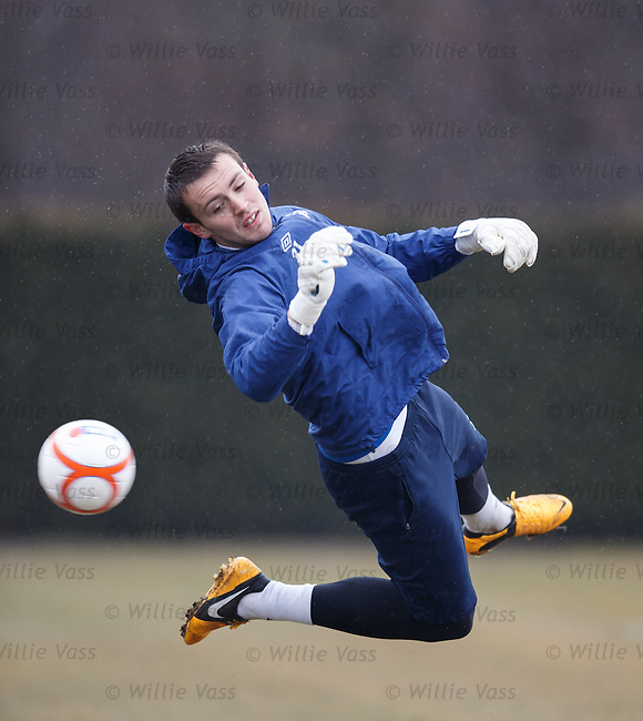 Goalkeeper Alan Smith in the practice nets saving shots from coach Jim Stewart and first choice stpper Neil Alexander