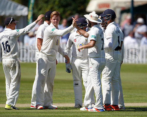 18.07.2016. Southport and Birkdale Cricket Club, Southport, England. Specsavers County Championship Cricket. Lancashire versus Durham. Durham celebrate the fall of the fifth Lancashire wicket, Brown caught off the bowling of Durham all-rounder Adam Hickey (second left).