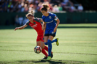 Seattle, WA - Saturday, August 26th, 2017: Ashleigh Sykes and Lauren Barnes during a regular season National Women's Soccer League (NWSL) match between the Seattle Reign FC and the Portland Thorns FC at Memorial Stadium.