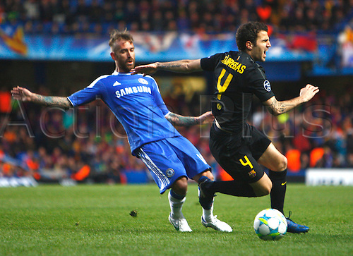 18.04.2012. Stamford Bridge, Chelsea, London. Chelsea's Raul Meireles and Cesc Fabregas of  FC Barcelona during the Champions League Semi Final 1st  leg match between Chelsea and Barcelona  at Stamford Bridge, Stadium on April 18, 2012 in London, England.............