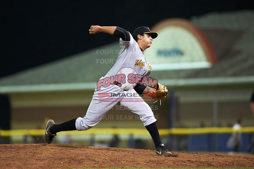 West Virginia Black Bears pitcher Julio Eusebio (32) delivers a pitch during a game against the Batavia Muckdogs on August 31, 2015 at Dwyer Stadium in Batavia, New York.  Batavia defeated West Virginia 5-4.  (Mike Janes/Four Seam Images)