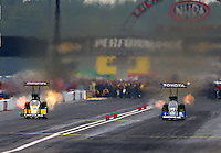 Sept. 2, 2013; Clermont, IN, USA: NHRA top fuel dragster driver Morgan Lucas (left) races alongside Antron Brown during the US Nationals at Lucas Oil Raceway. Mandatory Credit: Mark J. Rebilas-