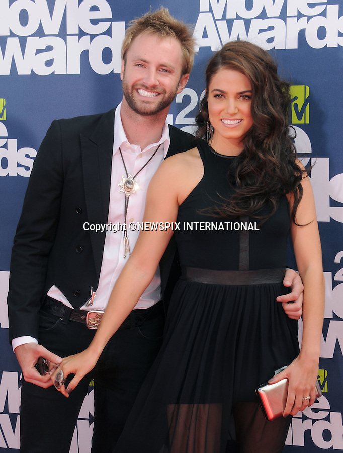 """NIKKI REED AND PAUL McDONALD.attends the 2011 MTV Movie Awards at the Gibson Amphitheatre on June 5, 2011 in Universal City, California.Mandatory Photo Credit: ©Crosby/Newspix International. .**ALL FEES PAYABLE TO: """"NEWSPIX INTERNATIONAL""""**..PHOTO CREDIT MANDATORY!!: NEWSPIX INTERNATIONAL(Failure to credit will incur a surcharge of 100% of reproduction fees)..IMMEDIATE CONFIRMATION OF USAGE REQUIRED:.Newspix International, 31 Chinnery Hill, Bishop's Stortford, ENGLAND CM23 3PS.Tel:+441279 324672  ; Fax: +441279656877.Mobile:  0777568 1153.e-mail: info@newspixinternational.co.uk"""