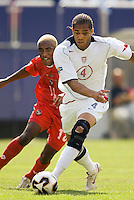 USA's Oguchi Onyewu is chased by Panama's Luis Tejada. The United States defeated Panama 3-1 in a shoot out after a scoreless game to win the CONCACAF Gold Cup at Giant's Stadium, East Rutherford, NJ, on July 24, 2005.