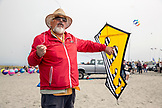 USA, Washington State, Long Beach Peninsula, Ron Gibian with his bearded man face kite at the International Kite Festival, Ron is a member of the Phoenix Kite Collective