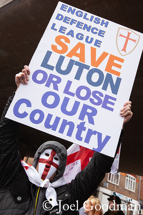 "© Joel Goodman - 07973 332324 . 05/05/2012 .  Luton , UK . A protester holds up a placard reading "" Save Luton or lose our country "" . Approximately 1,500 people take part in an EDL ( English Defence League ) march in Luton , understood to have been policed by over 1,000 officers . Photo credit: Joel Goodman"