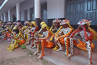 Fully prepared Pulikali performers wait before performance during annual Pulikali festival on 3rd Onam day at Trichur, Kerala, India..Pulikali or Kaduvvakali is a two hundred year old folk dance form, practised mostly in Thrissur and Palghat districts of Kerala. It liberally makes use of forms and symbols of nature that finds expression in its bright, bold body painting and high-energy dance movements. The philosophy of Pulikali is that human and nature are integral parts of each other. So by fusing man and beast in its artistic language, it flamboyantly celebrates the connection. Arindam Mukherjee