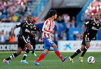 Atletico's Oliver and Granada's brahimi and Mikel Rico during La Liga BBVA match. April 14, 2013.(ALTERPHOTOS/Alconada)