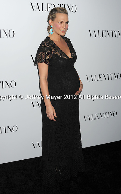 HOLLYWOOD, CA - MARCH 27: Molly Sims arrives at the Valentino 50th Anniversary And New Flagship Store Opening On Rodeo Drive at Valentino Boutique on March 27, 2012 in Beverly Hills, California.