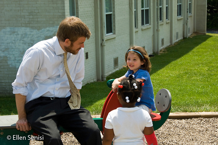 MR / Kensington, Maryland.Crossway Community Montessori School.Private, nonprofit early childhood education for children aged infant through age 6..Many of the students are children of parents from an associated program, Family Leadership School, for single-parent, low income families who live onsite..Primary Class.Teacher interacts with students on playground. Girl: 4.MR: Gri14, Dwy1.© Ellen B. Senisi