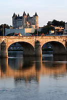 Chateau de Saumur along the river. The bridge. Saumur, Loire, France