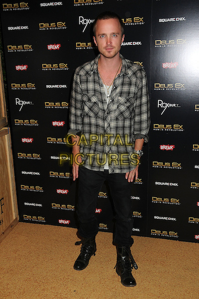"Aaron Paul.""Deus Ex: Human Revolution"" Launch Party held at The Roxbury, Hollywood, California, USA..August 23rd, 2011.full length white brown check black jeans denim shirt.CAP/ADM/BP.©Byron Purvis/AdMedia/Capital Pictures."