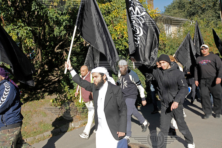 Radical muslims protest  a film mocking Islam outside the US embassy in Oslo, Norway. The gathering was small and passed peacefully. BASTIAN ALEXIS VASQUEZ  (center, white headwear) is as of jan 2015 presumed killed in Syria