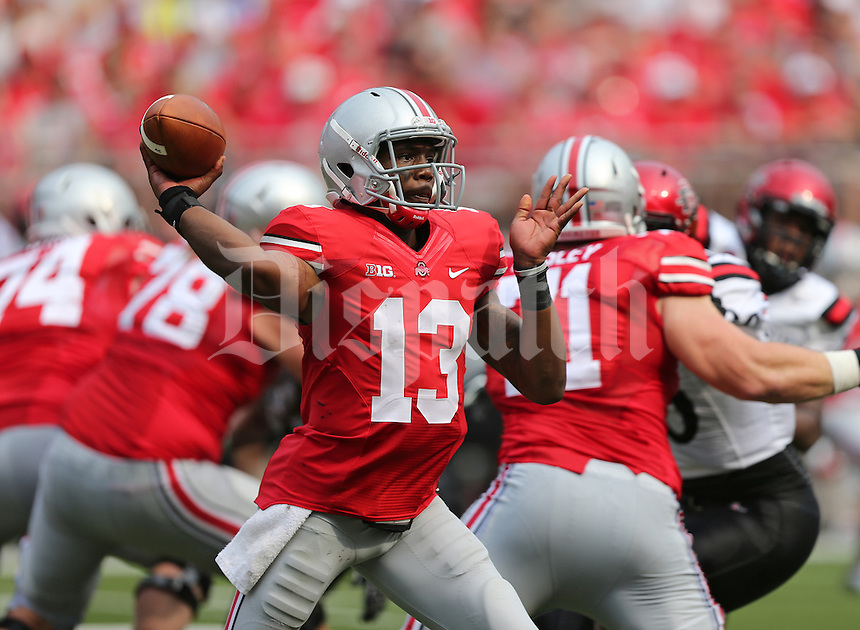 Ohio State Buckeyes quarterback Kenny Guiton (13) unleashes a pass in the second quarter of a football game between the Ohio State Buckeyes and the San Diego State Aztecs on Sept. 7, 2013 at Ohio Stadium. (Columbus Dispatch photo by Fred Squillante)