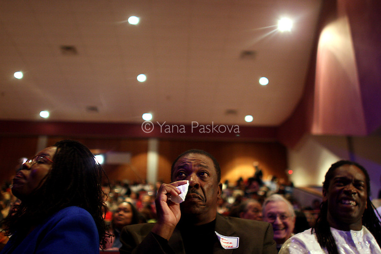 "(L-R) Antoinette Wright, 54, President of the DuSable museum, Earl Moore, 64, on the Board of Trustees for the museum, and Malik Camara, 47, teacher, (all from Chicago,) watch the inauguration of Barack Obama as President of the United States in the theater of the DuSable Museum of African-American History in Chicago, Illinois, on the Presidential Inauguration Day, Tuesday, January 20, 2009.  Camara said, ""I expect Obama to stay grounded, spiritually, mentally, and physically, because a lot in his job will be overwhelming, but as long as he stays grounded, he will be okay."" Camara's phone number: 773.239.1771 (Photo by Yana Paskova for The New York Times)..Assignment ID: 30075164A"