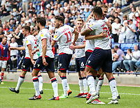Bolton Wanderers' Josh Magennis celebrates scoring with team mate Mark Beevers<br /> <br /> Photographer Andrew Kearns/CameraSport<br /> <br /> The EFL Sky Bet Championship - Bolton Wanderers v Bristol City - Saturday August 11th 2018 - University of Bolton Stadium - Bolton<br /> <br /> World Copyright &copy; 2018 CameraSport. All rights reserved. 43 Linden Ave. Countesthorpe. Leicester. England. LE8 5PG - Tel: +44 (0) 116 277 4147 - admin@camerasport.com - www.camerasport.com