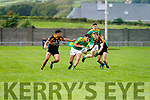 South Kerry's Graham O'Sullivan closed down by Stacks men Wayne Guthrie & Dylan Casey.