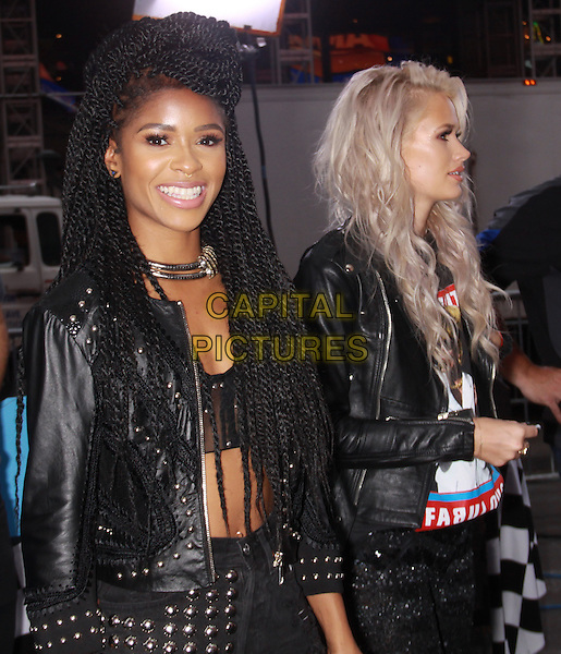 August  20, 2014: Simone Battle, Lauren Bennett, of G.R.L. perform at Good Morning America in New York. <br /> CAP/MPI/RW<br /> &copy;RW/ MediaPunch/Capital Pictures