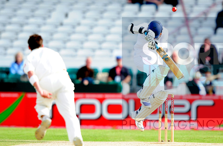 Stuart Broad of England takes evasive action against a Dale Steyn delivery