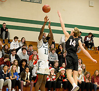 Memorial's Yacouba Traore Jr. shoots over Middleton's Parker Van Buren for two in the first period, as Middleton takes on Madison Memorial in Wisconsin Big Eight Conference boys basketball on Friday, 12/20/19 at James Madison Memorial High School in Madison