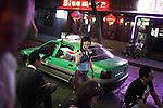 XIAN, CHINA - JUNE 1: An unidentified young woman leaves a trendy bar on June 1, 2007 in central Xian, China. Coffee street has many bar and clubs in the center of the city. The city has about 3,3 million inhabitants and is the capital of Shaanxi province in China. It was the eastern terminus for the Silk Road and the location for the Terracotta Army during the Qin Dynasty. Its history dates back more than 3,100 years. (Photo by Per-Anders Pettersson)..
