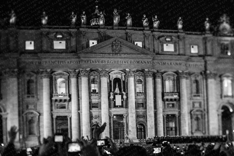 Newly elected Pope Francis, Cardinal Jorge Mario Bergoglio of Argentina appears on the balcony of St. Peter's Basilica after being elected by the conclave of cardinals, at the Vatican. Picture is taken with a tilt and shift lens.