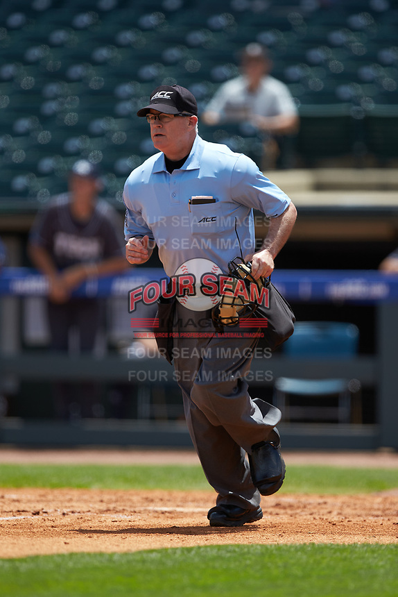 Home plate umpire Danny Collins jogs down the third base line in the game between the Miami Hurricanes and the Georgia Tech Yellow Jackets during game one of the 2017 ACC Baseball Championship at Louisville Slugger Field on May 23, 2017 in Louisville, Kentucky. The Hurricanes walked-off the Yellow Jackets 6-5 in 13 innings. (Brian Westerholt/Four Seam Images)