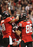 Texas Tech's Tramain Swindall, left, and Alexander Torres, right, celebrate a touchdown with Baron Batch during the second half of the Valero Alamo Bowl, Saturday, Jan. 2, 2010, at the Alamodome in San Antonio. Texas Tech won 41-31. (Darren Abate/pressphotointl.com)